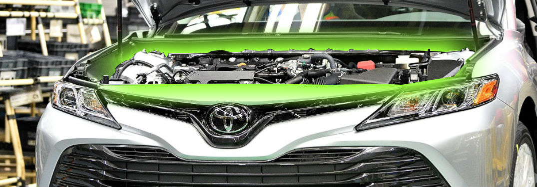 engine glowing from under the hood of 2018 toyota camry le