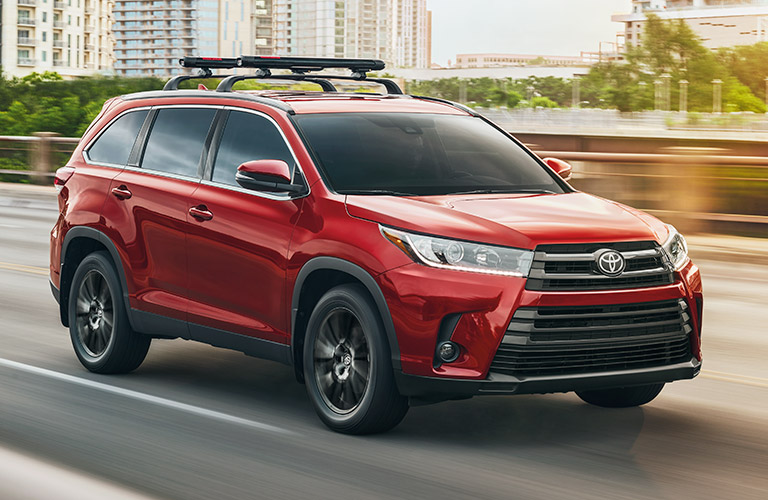 Exterior view of the front of a red 2019 Toyota Highlander