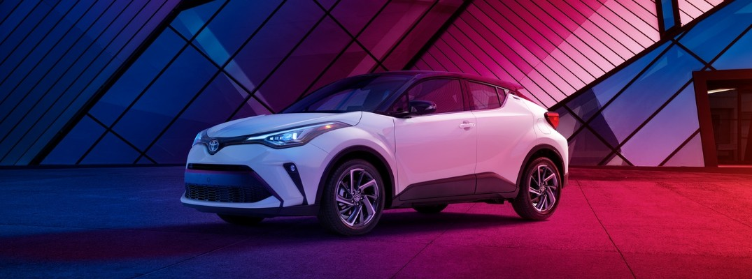 2020 Toyota C-HR parked against a red and blue background