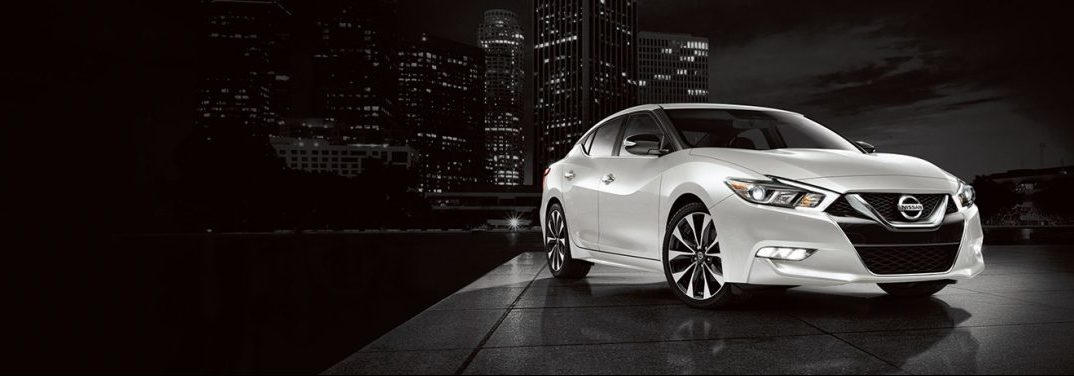 2018 Nissan Maxima with a city at night in the background high contrast