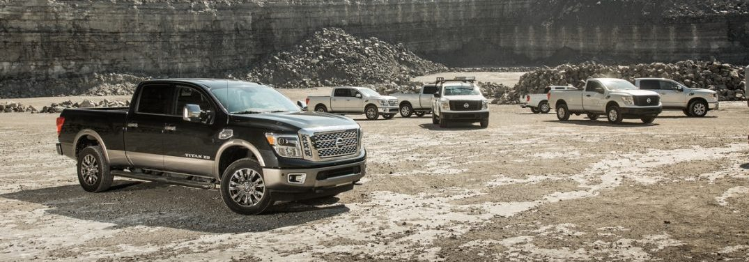 A bunch of 2018 Nissan Titan models parked at the bottom of a quarry