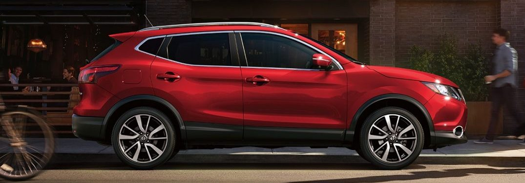 profile view of the 2018 Nissan Rogue Sport in red