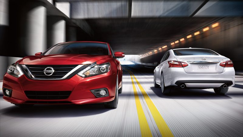 two 2018 Nissan Altima models driving past each other