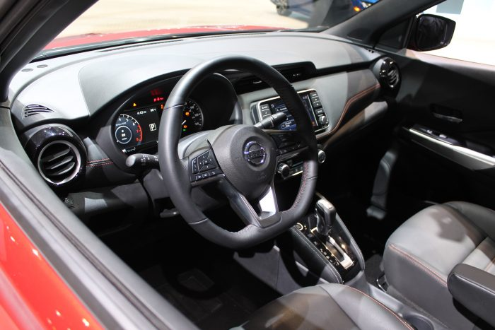 view of the front seats in the 2019 Nissan Kicks at the 2018 Chicago Auto Show