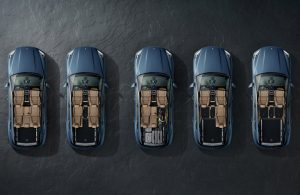 four 2019 Porsche Cayenne models lined up with the roofs opened