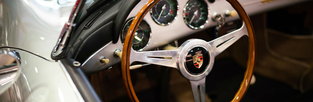 steering wheel of a classic Porsche car