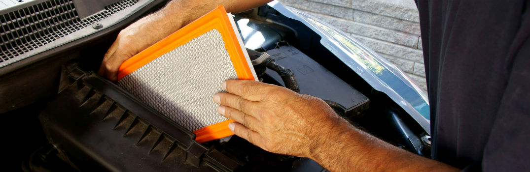 man replacing cabin air filter