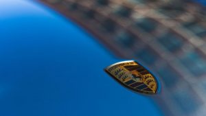 close-up of Porsche insignia