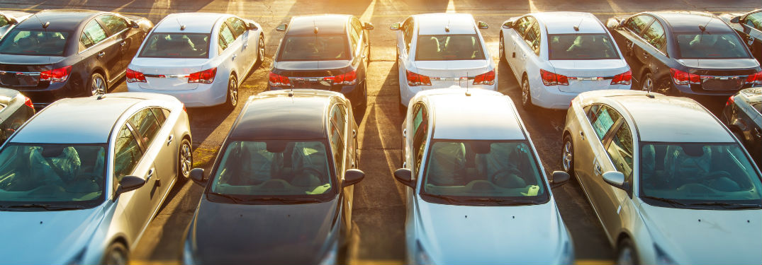 used vehicles lined up in a car lot