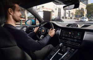 Man driving the 2020 Porsche Macan