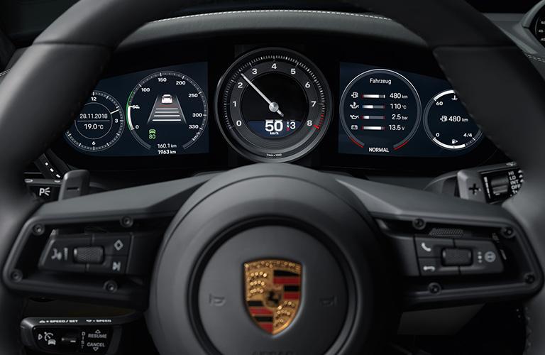 The multi-function sport steering wheel inside a 2020 Porsche 911 model.
