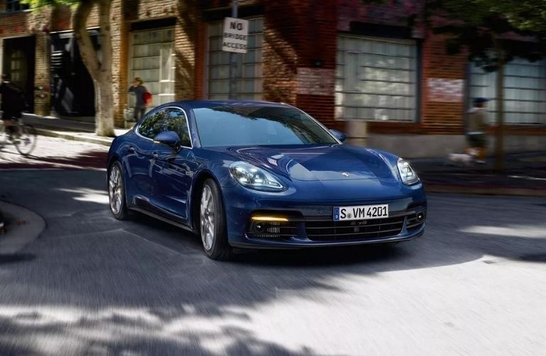 Exterior view of the front of a blue 2020 Porsche Panamera