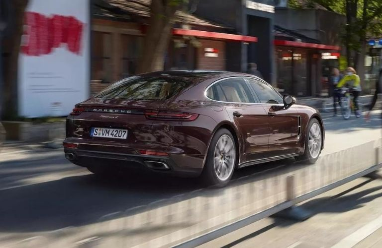Exterior view of the rear of a maroon 2020 Porsche Panamera