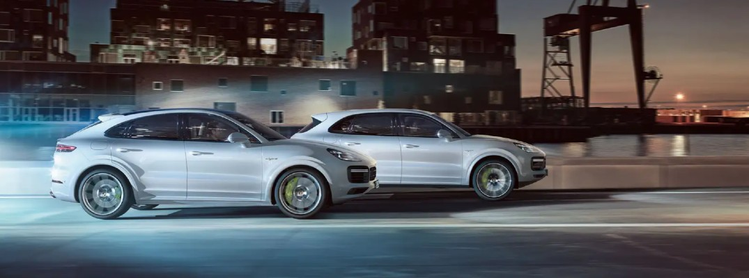 A photo of two 2020 Porsche Cayenne models on the road.