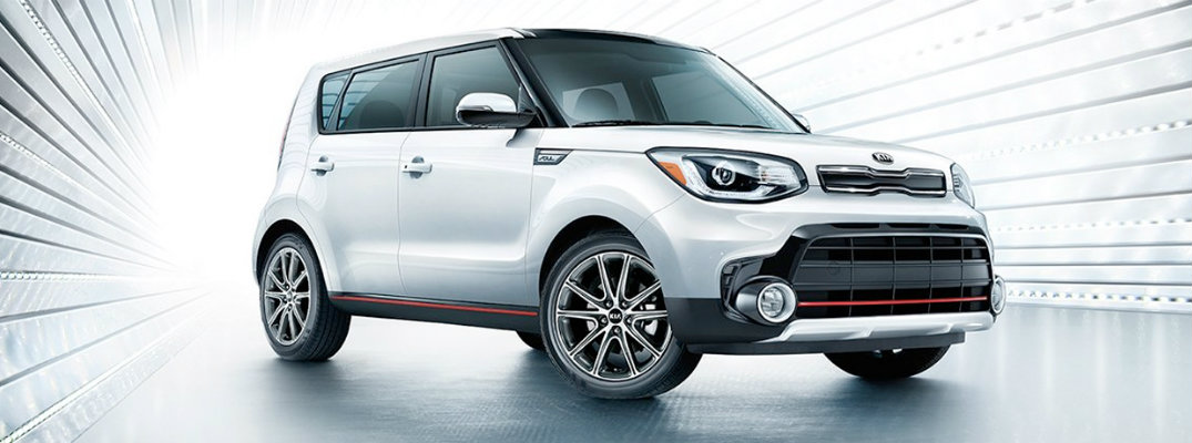 Silver 2019 Kia Soul in a back-lit studio