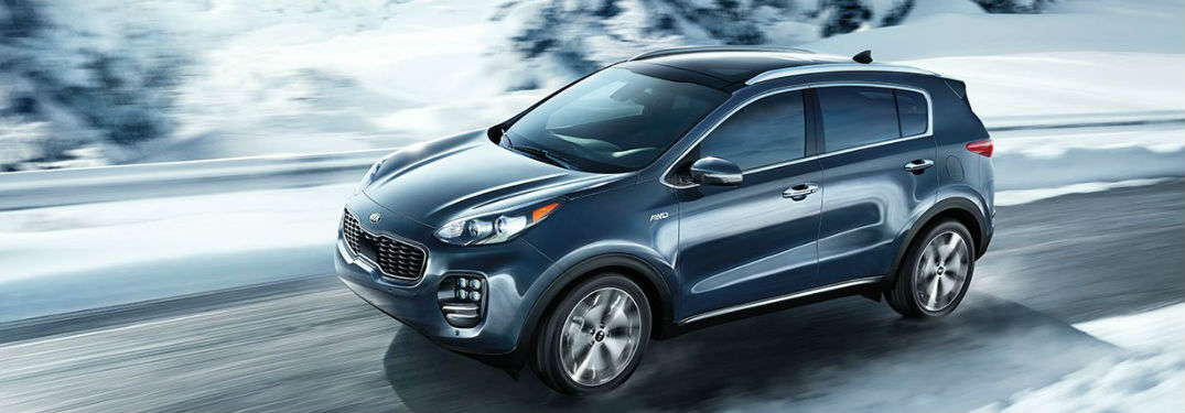 Kia Sportage driving a road