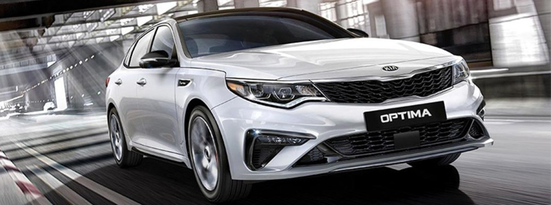 front end of the 2019 Kia Optima driving down the road