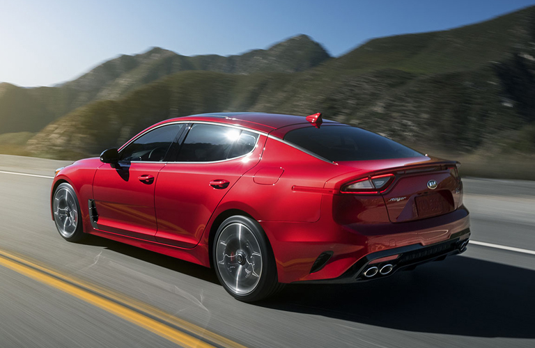 A left rear quarter photo of the 2019 Kia Stinger on the road.