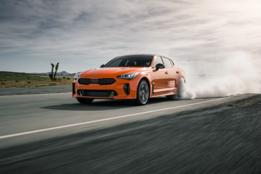 A photo of the 2020 Kia Stinger GTS smoking its tires on a race track.