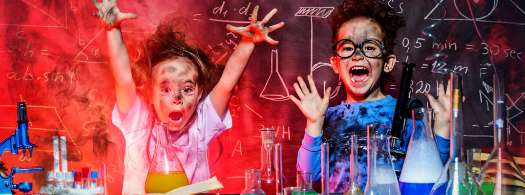 A stock photo of some kids doing a science experiment.