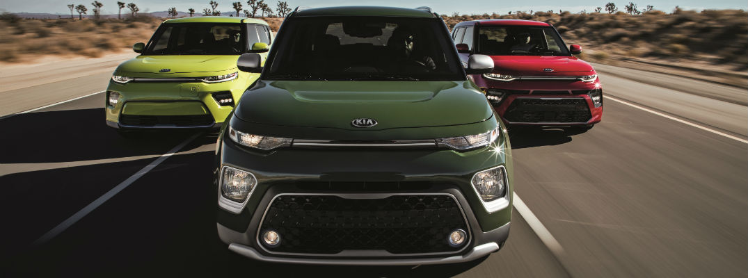 A photo of the three 2020 Kia Soul models line abreast on the road.