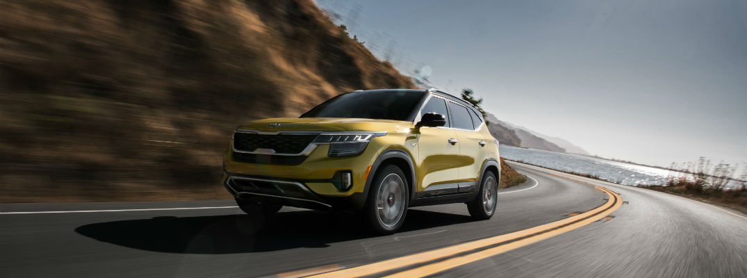 A front left quarter photo of the 2021 Kia Seltos on the road.