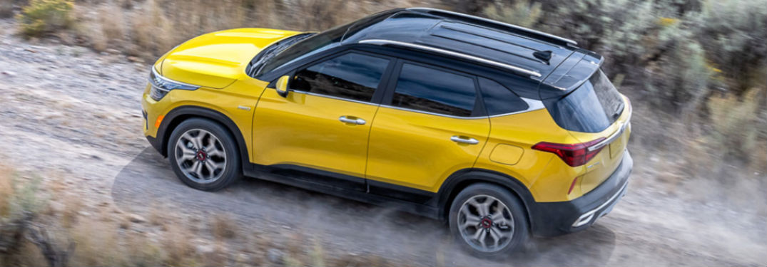 2021 Kia Seltos exterior driver side going uphill on dirt road