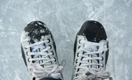 Black and white ice skates on ice