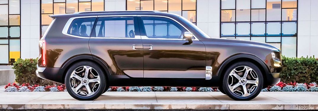 2020 Kia Telluride exterior passenger side profile in front of building windows