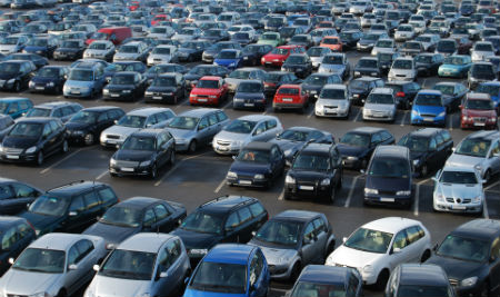 Car lot filled with hundreds of cars