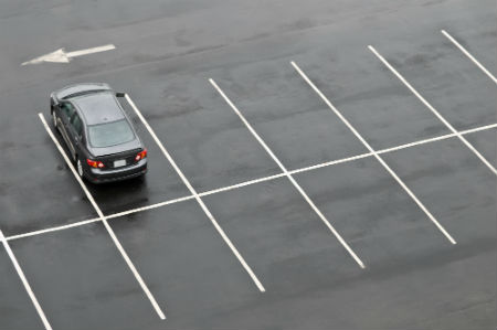 Car in empty parking lot