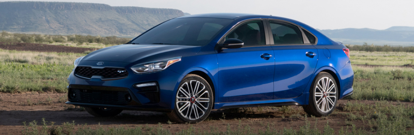 2020 Kia Forte exterior front fascia driver isde in empty field with mountains in background