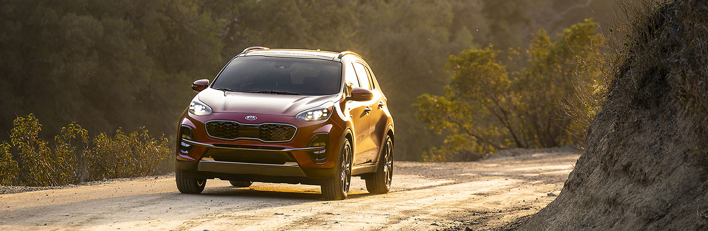 2020 Kia Sportage exterior front fascia driver side on road with sunlight