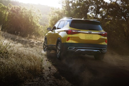 2021 Kia Seltos exterior rear fascia driver side offroad with trees and sunlight