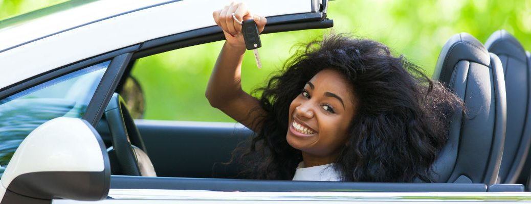 Woman in convertible holding up car key
