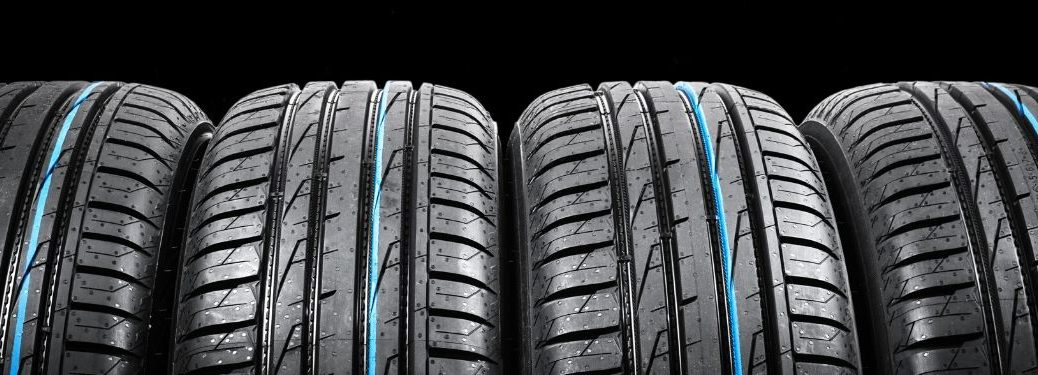 4 tires with blue streak lined up in a row
