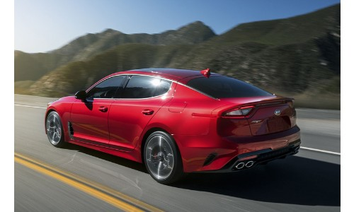2019 Kia Stinger exterior front fascia driver side on highway with mountains
