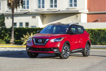 2018 Nissan Kicks parked in front of large building