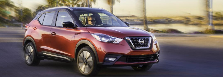 2018 Nissan Kicks driving fast down a street