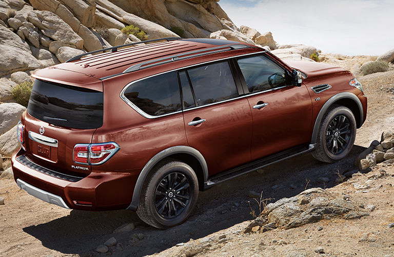2018 Nissan Armada driving up a rocky hill