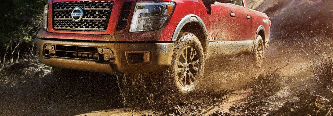 Which 2018 Nissan Models have All-Wheel Drive? with image of a muddy 2018 Nissan TITAN