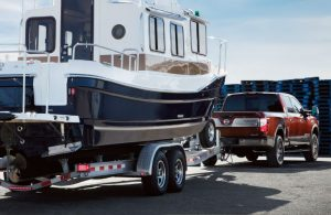 2018 Nissan TITAN XD towing a large boat
