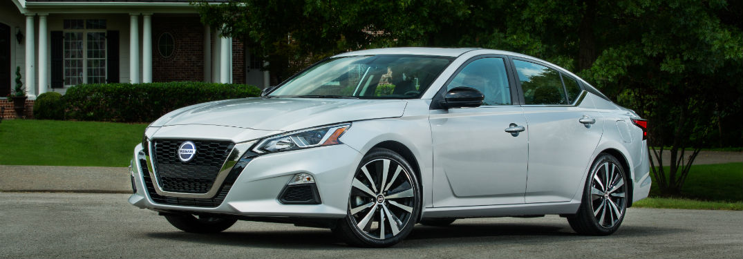 What's new on the 2019 Nissan Altima? with image of a 2019 Nissan Altima parked by a house