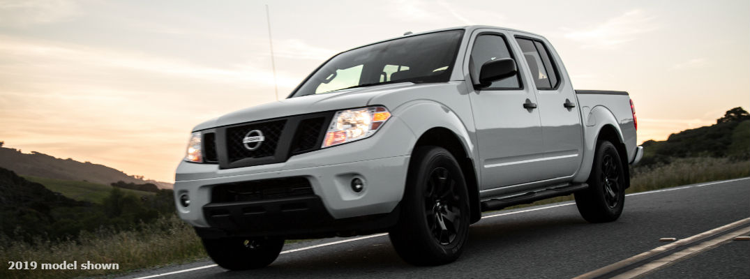 A front left profile photo of the 2019 Nissan Frontier on the road.