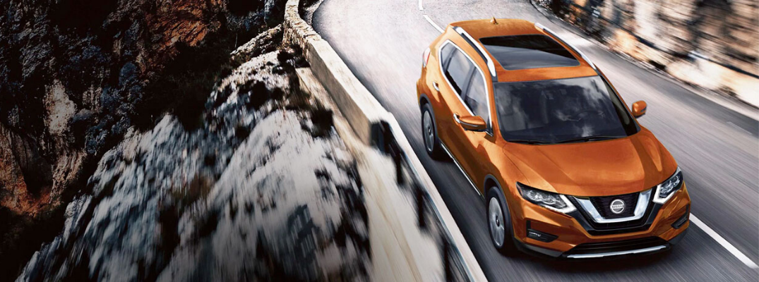 Orange 2020 Nissan Rogue on the road
