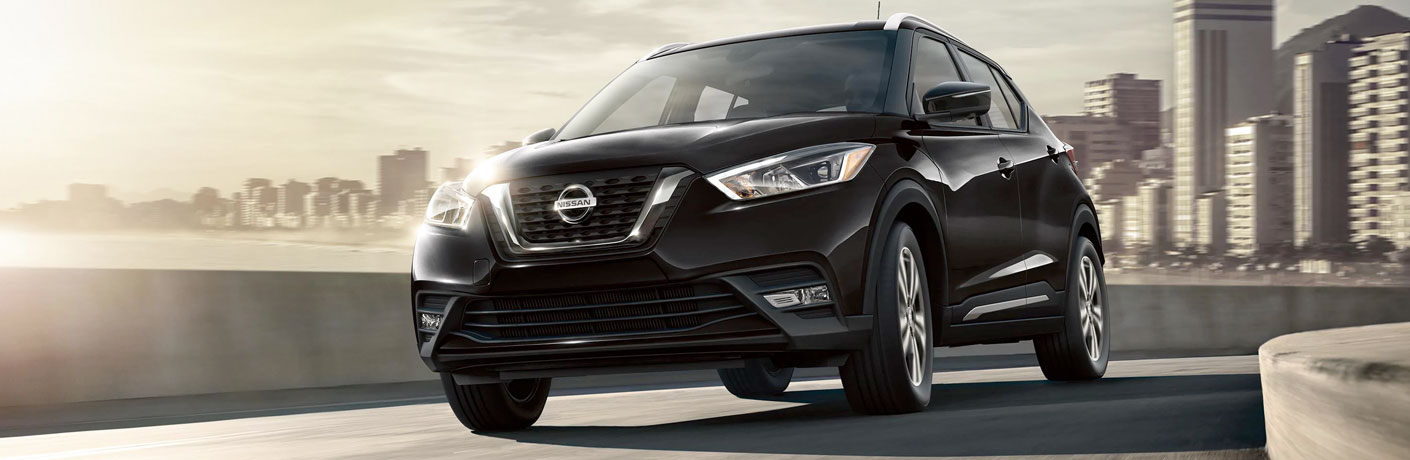 Front view of black 2020 Nissan Kicks on city road