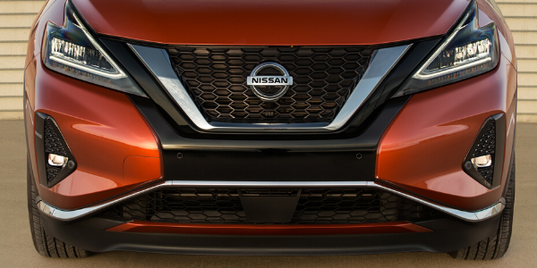 Front grille and LED headlights of orange 2020 Nissan Murano