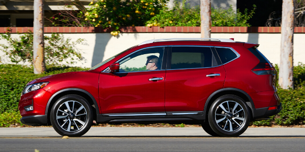 Side view of red 2020 Nissan Rogue