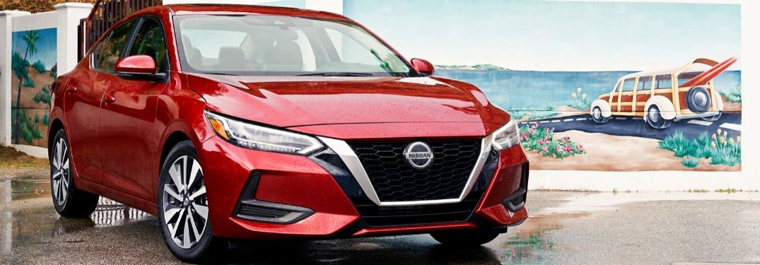 Red 2020 Nissan Sentra in Front of Beachfront Mural