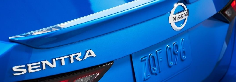 Close Up of Nissan Sentra Rear Exterior Badge on Blue 2020 Nissan Sentra